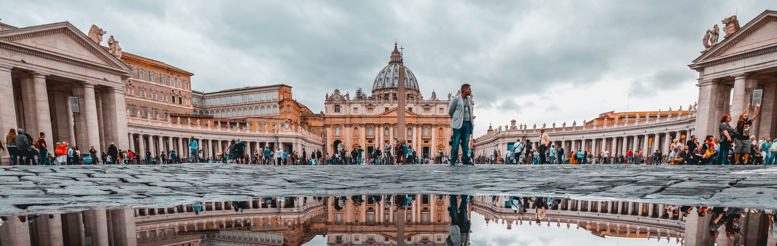 Pilgrims stand outside St. Peter's Basilica, Vatican City
