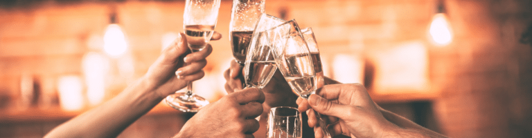 Glasses raised to toast Catholic pilgrimage company Verso Ministries for their fourth anniversary in 2020.