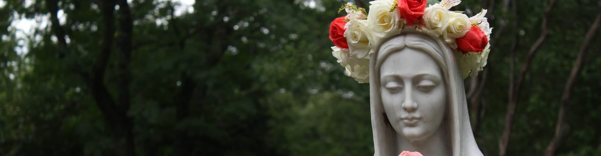 During May Crowning, a crown of flowers is placed on a statue of Mary.