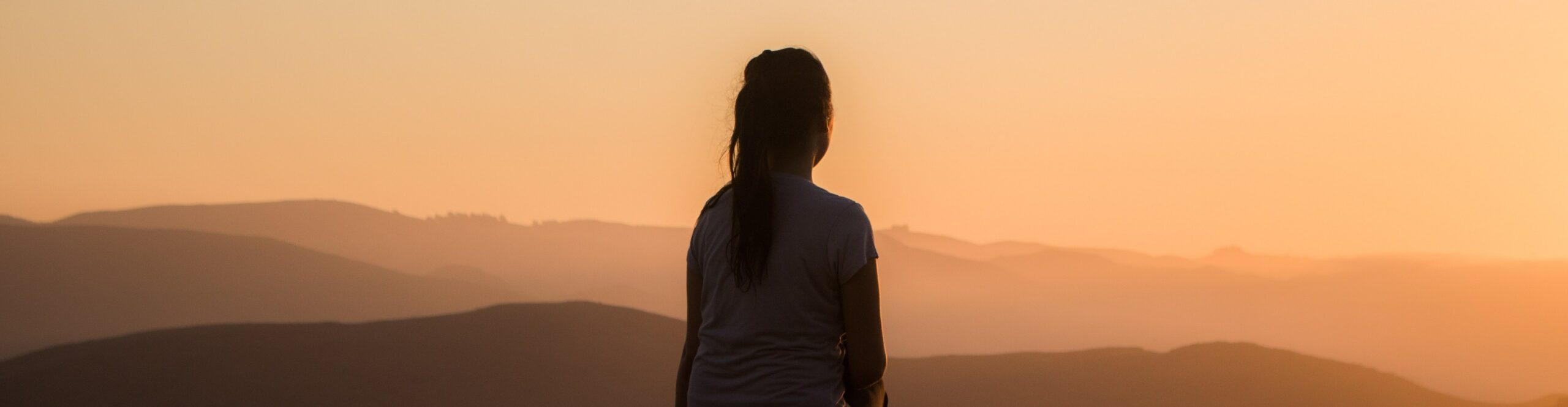 A pilgrim finding God in silence atop a mountain